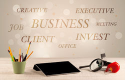 Business office desk with writing on wall Stock Image