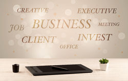 Business office desk with writing on wall Royalty Free Stock Image