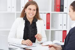 Business, office, law and legal concept - picture of two Caucasian woman signing contract paper. stock images