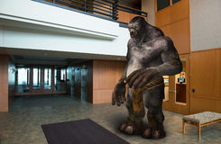 Business Office Lobby Building Troll. A troll is in the business office lobby of a modern building. Every workplace has a troll working on the job Stock Photography