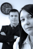 Business office partners. Men and woman in office with clock on the wall Stock Photography