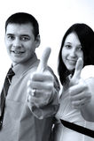 Business office partners. Business partners with thumbs up Stock Images