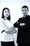 Business office partners. Portraits of serious men and woman in office Royalty Free Stock Photography