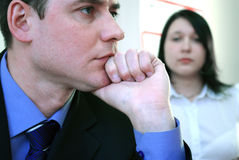 Business office partners. Sad and depresed business couple - portrait Stock Images