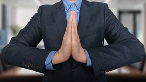 Business and office, people concept - praying young buisnessman Stock Photography