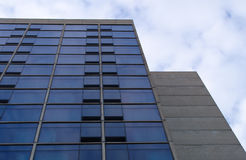 Concrete glass building office tower business. Business office tower building concrete glass facade Stock Image