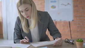 Business office woman working hard on a project. Manager makes notes on paper 4K. Business office woman working hard on a project. Manager makes notes on paper stock video