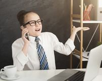 Cheerful little girl taking order by phone stock photos
