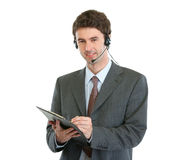 Business operator with headset and clipboard Royalty Free Stock Image
