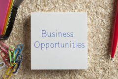 Business Opportunities written on a note. Top view of Business Opportunities written note on the wood chippings board Royalty Free Stock Photo