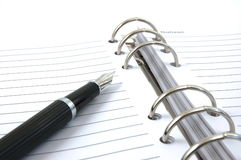 Business organizer and pen Stock Photos