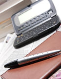 Business organizer with pen  Stock Image