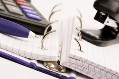 Business organizer, pen, calculator and stapler Stock Image