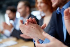 Business ovation. Photo of business partners� hands applauding at the meeting Stock Photos