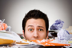 Business: Overwhelmed Businessman Buried In Trash. Series with a businessman overwhelmed and buried by work Stock Image