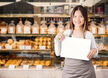 Business owner with bakery shop background. Female business owner with bakery shop background royalty free stock images