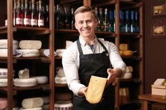 Business owner with cheese in store. Business owner with cheese in his store stock photos