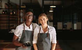 Business owner couple at their coffee shop Stock Photography