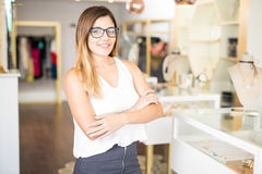 Business owner of a fashion store. Portrait of a gorgeous young Hispanic business owner standing in front of her jewelry and fashion store royalty free stock photography