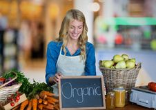 Business owner with organic food against blurry background Royalty Free Stock Photography