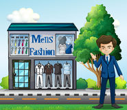 A business owner outside the men's fashion shop Stock Images
