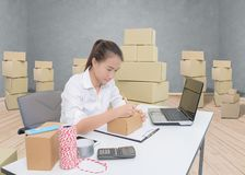 Business owner woman working online shopping prepare product pac royalty free stock images