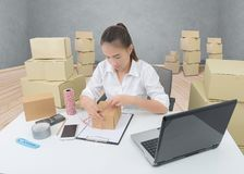 Business owner woman working online shopping prepare product pac stock photos