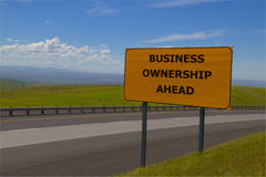 `Business Ownership Ahead` Yellow Road Sign. Conceptual Royalty Free Stock Photo