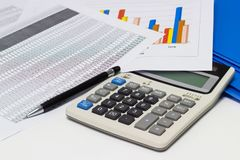 Business paper graphs and pen with charts report, calculator on desk of financial planning Royalty Free Stock Photography
