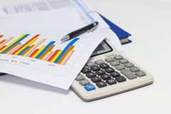 Business paper graphs and pen with charts report, calculator on desk of financial planning Stock Image