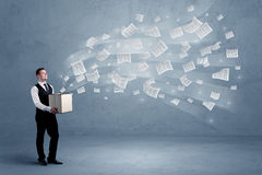 Business papers flying from box Stock Images