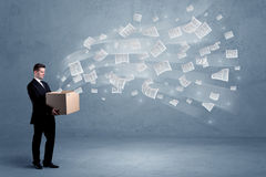 Business papers flying from box Stock Photos