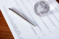 Business Papers With Glass Globe Royalty Free Stock Photo