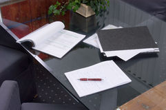 Business papers on a table. From glass Stock Image