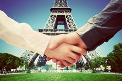 Business in Paris, France. Handshake on Eiffel Tower background royalty free stock images