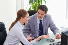 Business partner discussing in the office. Young business partner discussing in the office Royalty Free Stock Photo