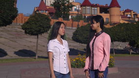 Business partner meet and have conversation. Two asian women meeting in the city. Adult female meet outdoors greeting shake hands. Young professional woman stock video