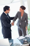 Business partner shaking hands after closing a deal Royalty Free Stock Images