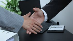 Business partner shaking hands stock footage