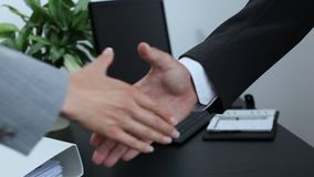 Business partner shaking hands 4 stock footage