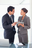 Business partner standing with tablet in their hands Stock Photography
