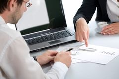 Business partners. Image of two business partners discussing documents lying on the table stock photos