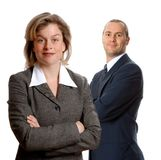 Business partners. Woman in a grey jacket on an isolated white with businessman royalty free stock photography
