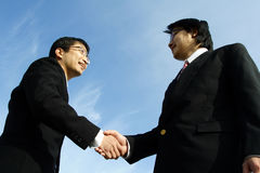 Business partners. Two businessmen shaking hands on a deal (focus on the hands Royalty Free Stock Photography