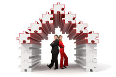 Business partners - 3d puzzle house. Business partners standing in a 3d rendered puzzle house - Isolated Royalty Free Stock Image