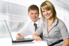 Business partners. Two smiling business peoples near the laptop Royalty Free Stock Photo