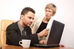 Business partners in action. Man and woman working together in the office stock images