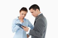 Business partners analyzing document Stock Photo
