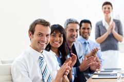Business partners applauding a presentation Stock Photography