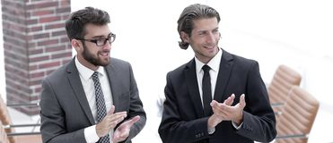 Business partners applauding ,standing in the office. Photo with copy space Royalty Free Stock Photography